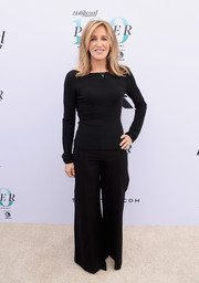 Felicity Huffman matched her top with black wide-leg pants.