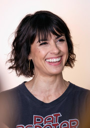 Constance Zimmer rocked messy waves and wispy bangs at the Hollywood Reporter's Women in Entertainment Breakfast.