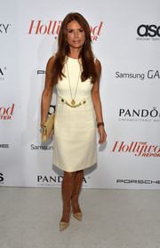 Roma Downey chose a '60s-chic little white dress with a chain-embellished waist for the Hollywood Reporter Emmy party.