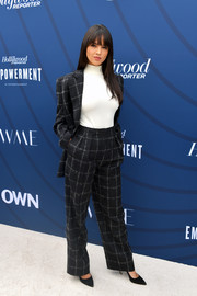 Eiza Gonzalez went the menswear-chic route in a grid-patterned pantsuit by Boss at the Hollywood Reporter's Empowerment in Entertainment event.