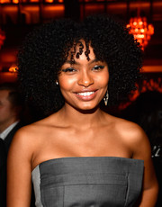 Yara Shahidi sported a thick silver cat eye to match her outfit.