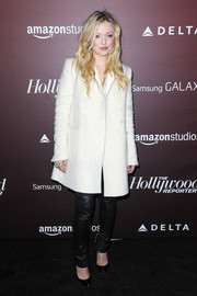 Francesca Eastwood was cozy and stylish in a white trenchcoat during the Next Gen 20th anniversary gala.