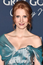 Jessica Chastian attended 'The Hollywood Reporter' Celebration of the 84th Annual Academy Awards wearing her hair in a romantic updo that included face-framing spiral curls.