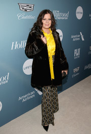 Marcia Gay Harden's printed bell-bottoms are giving us hippie vibes.