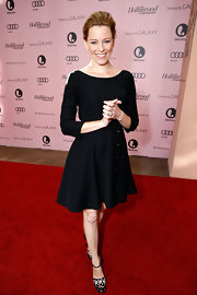Elizabeth Banks kept things sweet and simple in this black dress with dainty button details.