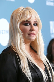 Kesha wore her long hair down in a layered style at the Hollywood Reporter's Power 100 Women in Entertainment event.