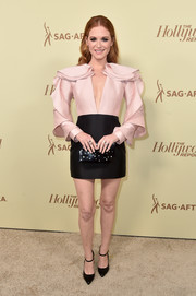 Sarah Drew accessorized with a beaded black clutch by Emm Kuo.