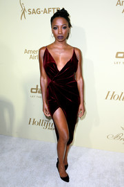 Shanola Hampton ravished in a curve-hugging velvet wrap dress by Meshki at the Hollywood Reporter and SAG-AFTRA Emmy nominees night.