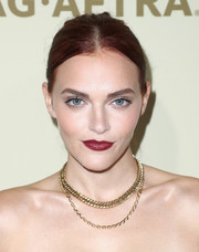 Madeline Brewer's red lipstick looked striking against her alabaster skin.