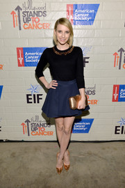 Emma Roberts added more shine to her look via a metallic gold Rebecca Minkoff clutch.