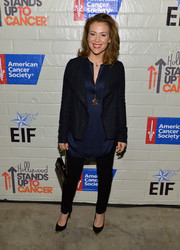 Alyssa Milano kept her look simple yet stylish with this black blazer and navy tunic combo at the Hollywood Stands Up to Cancer event.