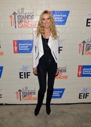 Alana Stewart completed her tough-chic outfit with a pair of knee-high black suede boots.