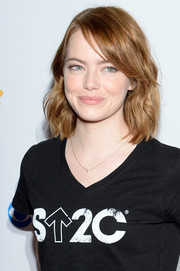 Emma Stone kept it youthful with this wavy 'do with side-swept bangs at the Stand Up to Cancer event.