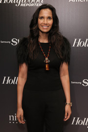 Padma Lakshmi jazzed up her dark outfit with an oversized pendant necklace for the 35 Most Powerful People in Media event.