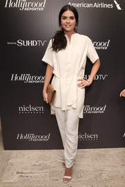 Katie Lee was casual-chic in her all-white slacks and tunic combo.