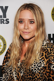 "Mary-Kate Olsen showed off her long wavy locks while hitting up the ""High Rollers"" premiere in New York."
