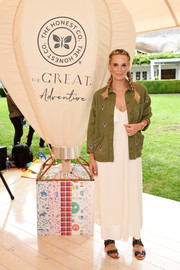 Molly Sims layered an embellished army jacket over a white maxi dress for the GREAT Adventure event.