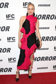 Chloe Sevigny was a visual explosion at the '#Horror' New York premiere in this magenta Proenza Schouler design featuring black patches, ruffles, a hip cutout, and a side slit.