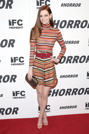 Lydia Hearst kept up the colorful, linear theme with a pair of strappy tan, coral, and purple heels.