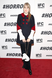 That navy and red pea coat Tennessee Thomas wore to the '#Horror' New York premiere looked absolutely adorable!