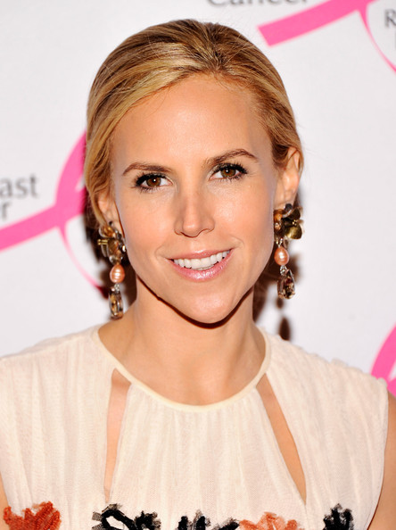 Tory Burch added a touch of frosty peachy-pink lipstick to her look at the Hot Pink Party.