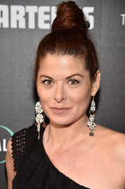 Debra Messing styled her hair into a towering top knot for the New York screening of 'Hotel Artemis.'