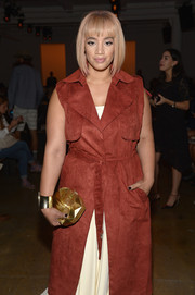 Dascha Polanco styled her outfit with a geometric gold clutch when she attended the Houghton fashion show.
