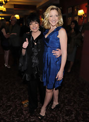 Liza Minnelli was spotted at a Broadway opening show wearing a loose top with a satin ruffle trim.