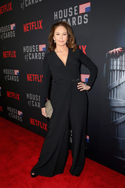 Diane Lane paired her jumpsuit with a taupe ostrich-leather clutch.
