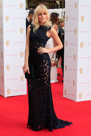 Pixie Lott showed a hint of skin in a midnight blue macrame lace gown by Blumarine at the British Academy Television Awards.