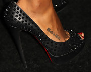 Kelly Rowland attended the House of Hype's 2011 MTV Video Music Awards after party rocking some ultra-edgy Louboutin's that left her tattoo clearly visible.