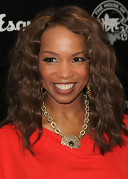 Elise Neal arrived at the House of Hype's 2011 MTV Video Music Awards after party with subtle caramel highlights and soft, shiny waves.