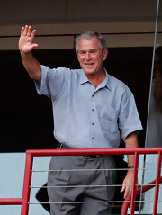 George W Bush stayed casual in a short sleeved blue shirt.