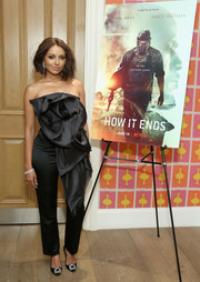 Kat Graham looked fashion-forward in a strapless black jumpsuit by Ester Abner with an oversized rosette accent at the New York screening of 'How It Ends.'