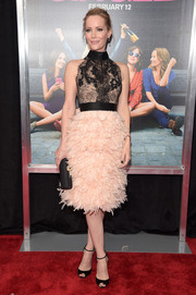 Leslie Mann looked jaw-dropping in a Marchesa cocktail dress with a sheer-illusion lace bodice and a feather skirt at the New York premiere of 'How to Be Single.'