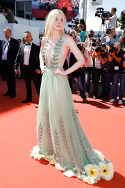 Elle Fanning went for whimsical glamour in a seafoam-green Gucci halter gown with a flower-appliqued hem at the Cannes Film Festival screening of 'How to Talk to Girls at Parties.'
