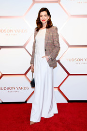 Anne Hathaway looked smart in a glen plaid blazer by Tommy x Zendaya at the Hudson Yards VIP grand opening.