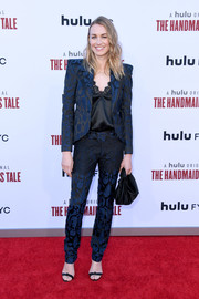Yvonne Strahovski teamed her suit with black knot-detail sandals by Alexandre Birman.