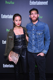 Jamie Chung looked tough in a military jacket layered over a leather jumpsuit during Hulu's New York Comic Con after-party.