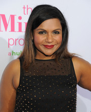 Mindy Kaling wore her hair down to her shoulders in a straight, side-parted style at the 'Mindy Project' season 4 premiere.