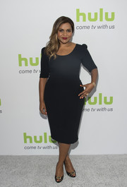 Mindy Kaling styled her dress with a pair of beaded lace peep-toes, also by Dolce & Gabbana.