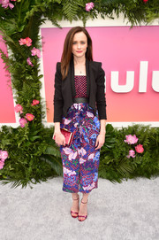 Alexis Bledel added more color with a fuchsia velvet clutch by Hayward.