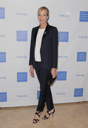 Allison Janney styled her suit with black cross-strap sandals.