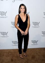 Nikki Reed put her cleavage on show in a plunging black jumpsuit during the Humane Society of the United States' To The Rescue Gala.