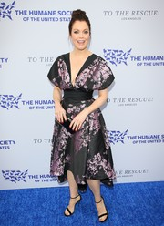 Bellamy Young cut a shapely silhouette in a printed cocktail dress with a cinched-in waist at the To the Rescue! Los Angeles Gala.