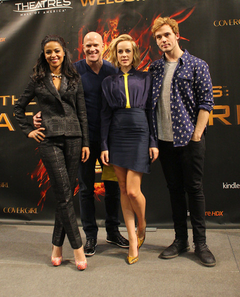Jena Malone donned a long-sleeve purple and yellow blouse by Vionnet for 'Hunger Games' mall tour in Minnesota.