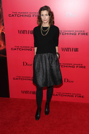 Bridget Moynahan completed her fall-chic ensemble with a pair of black ankle boots.
