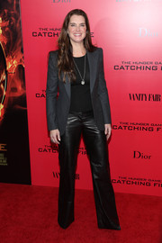 Brooke Shields suited up in a menswear-chic gray blazer for the 'Catching Fire' NYC premiere.
