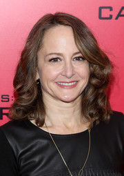 Nina Jacobson sweetened up her look with feminine curls when she attended the 'Catching Fire' NYC premiere.
