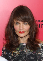 Helena Christensen attended the 'Catching Fire' NYC premiere wearing her hair in subtle waves with emo bangs.